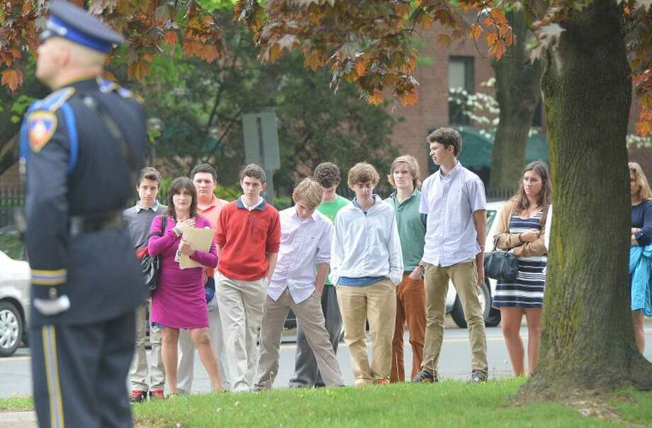 Hour Photo/Alex von Kleydorff A Group of students stop and watch the ceremony during Peace Officers Memorial Day service at Stamford Police Headquaters