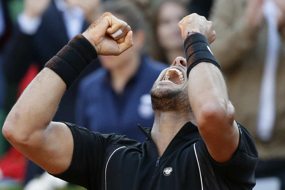 France's Jo-Wilfried Tsonga celebrates winning in the quarterfinal match of the French Open tennis tournament against Japan's Kei Nishikori in five sets 6-1, 6-4, 4-6, 3-6, 6-3, at the Roland Garros stadium, in Paris, France, Tuesday, June 2, 2015. (AP Photo/Thibault Camus)