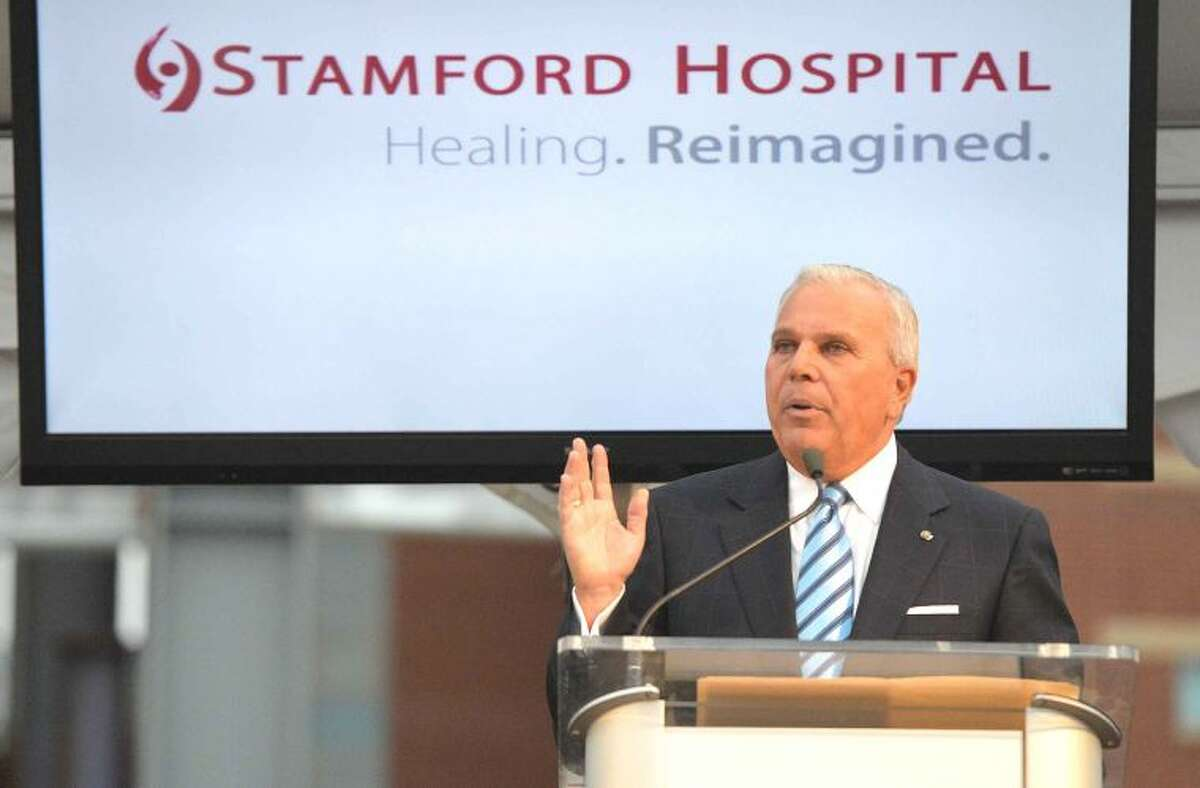 Hour Photo/Alex von Kleydorff Stamford Hospital Board of Directors Chairman Micheael Fedele speaks during the Topping Off Ceremony for Stamford Hospitals new facility