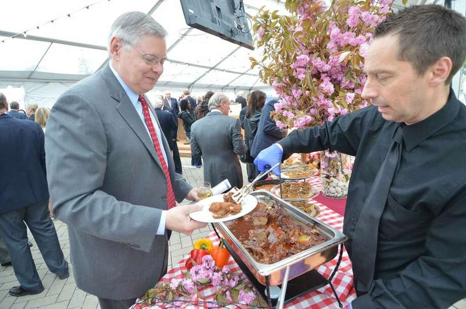 Hour Photo/Alex von Kleydorff Stamford Mayor David Martin trys the Southern Barbeque table at the reception during the Topping Off Ceremony for Stamford Hospitals new facility