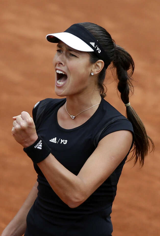 Serbia's Ana Ivanovic reacts as she plays Ukraine's Elina Svitolina during their quarterfinal match of the French Open tennis tournament at the Roland Garros stadium, Tuesday, June 2, 2015 in Paris. Ivanovic won 6-3, 6-2. (AP Photo/Thibault Camus)