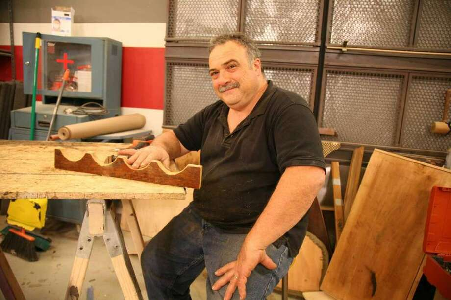 Mark DeVito, of Stamford, started making furniture alongside his father, who opened his own business, Raphael's Furniture Restoration, in 1959. (Photo: Sylvia Bors / Contributed Photo)