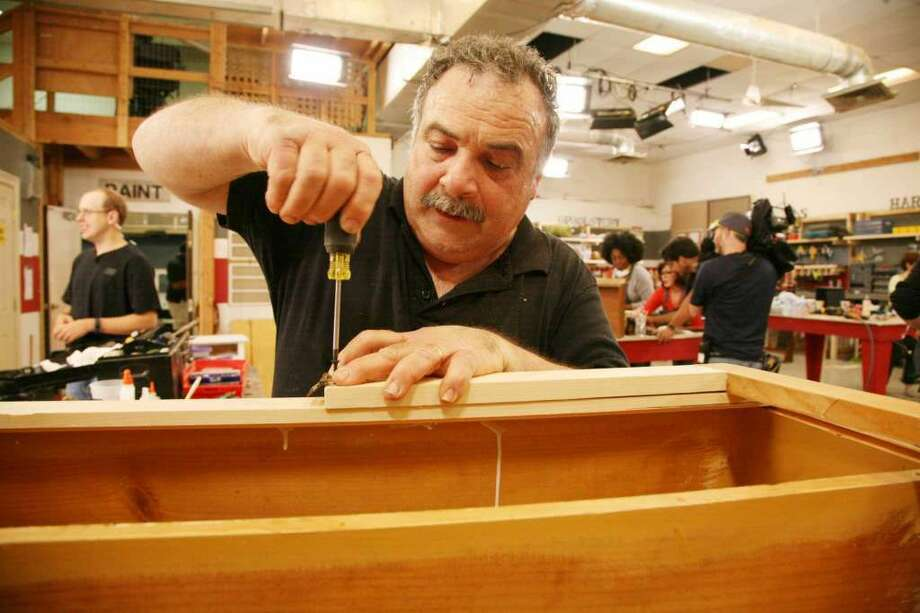 """Mark DeVito, of Stamford, works on projects for contestants on """"Flea Market Flip.""""(Photo:Sylvia Bors / Contributed Photo)"""