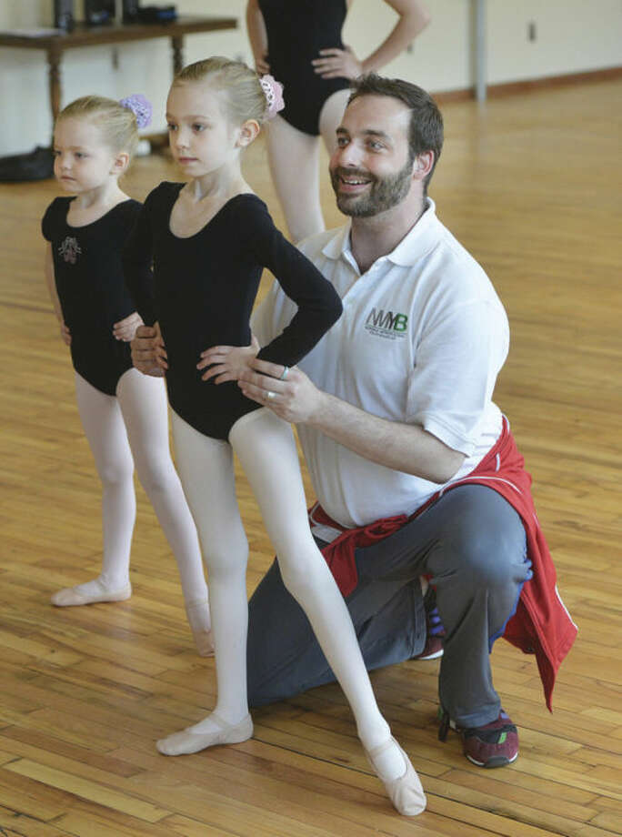 Hour Photo/Alex von Kleydorff Artistic Director Adam Holms works with sisters 7yr old Ana, and 5yr old Lily Brake during one of the classes