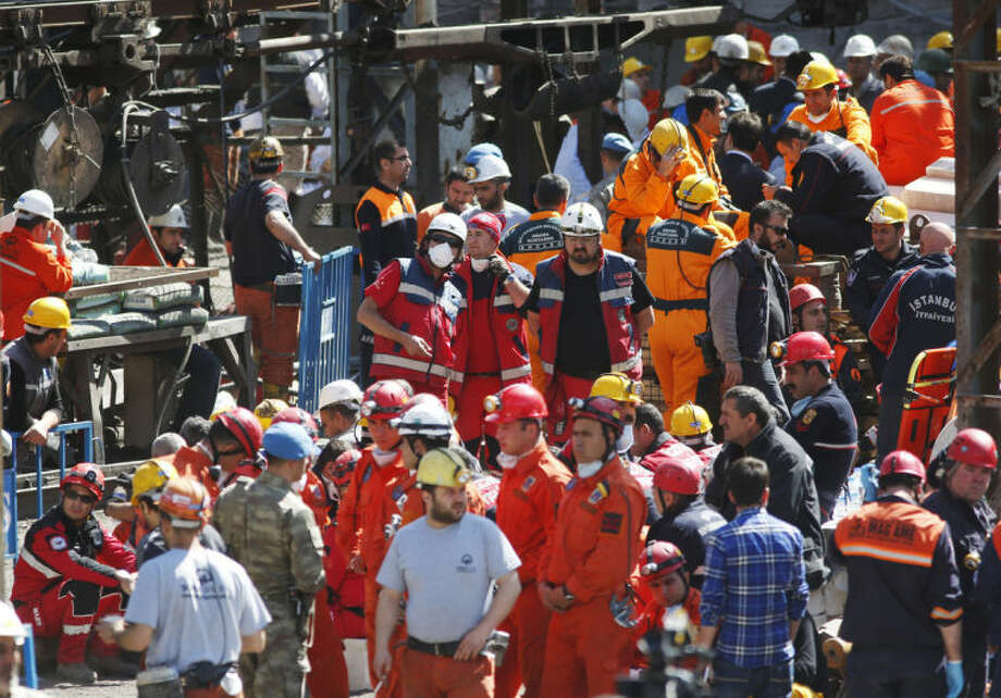 Miners and members of the rescue services wait outside a coal mine in Soma, western Turkey, Thursday, May 15, 2014. An explosion and fire at the coal mine in Soma, some 250 kilometers (155 miles) south of Istanbul, killed hundreds of workers, authorities said, in one of the worst mining disasters in Turkish history. (AP Photo/Lefteris Pitarakis)