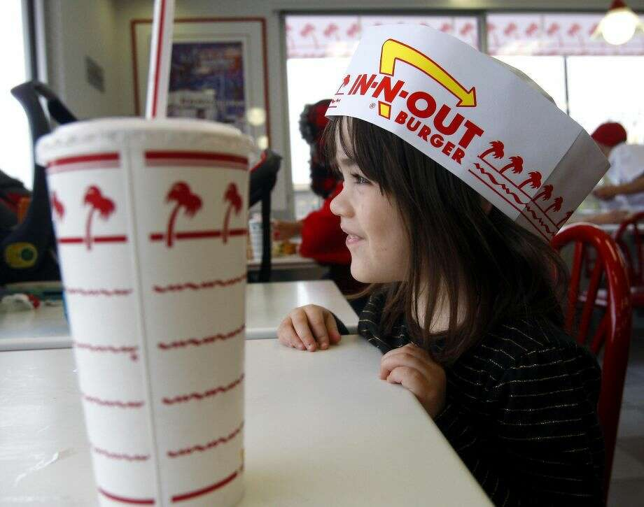 Rylee Jones wears a paper hat as she attends the grand opening Thursday Nov. 20, 2014 of San Antonio's first In-N-Out Burger. (Photo: William Luther, San Antonio Express-News)