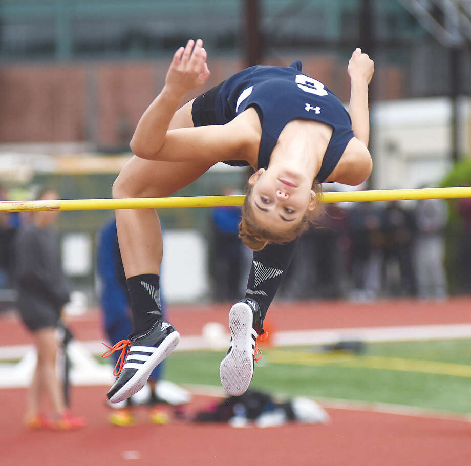Hour photo/John Nash - Elizabeth Knoll of Staples soars over the high jump.