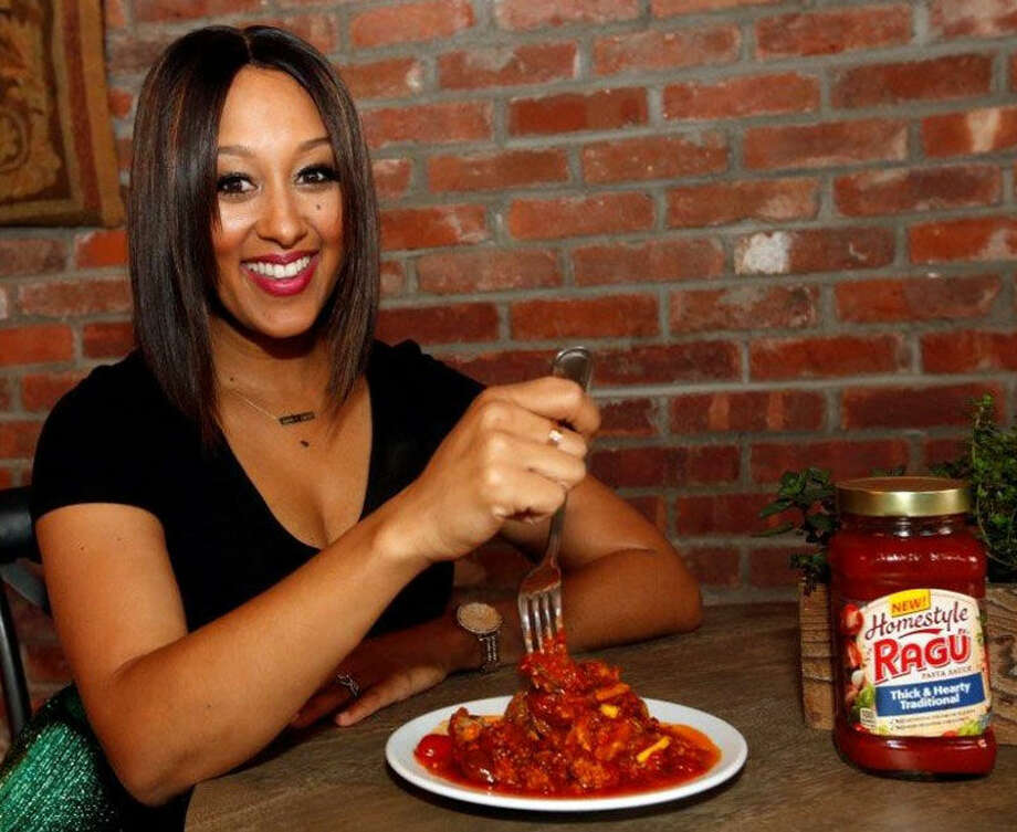 Tamera Mowry-Housley Encourages Parents to Reclaim Family Dinner Nights