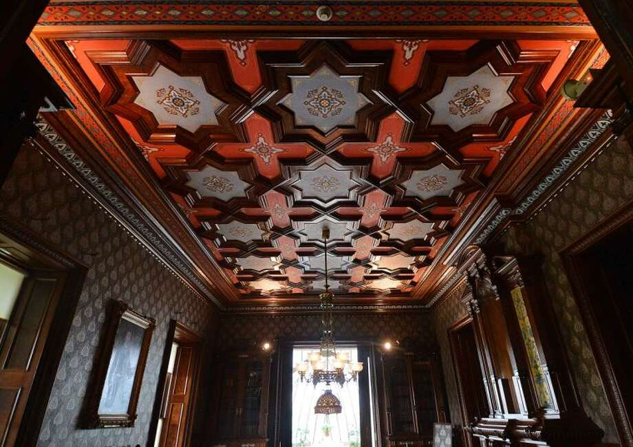 Hour Photo / Alex von Kleydorff At The Lockwood Mathews Mansion Library the ceiling shines after months of restoration.