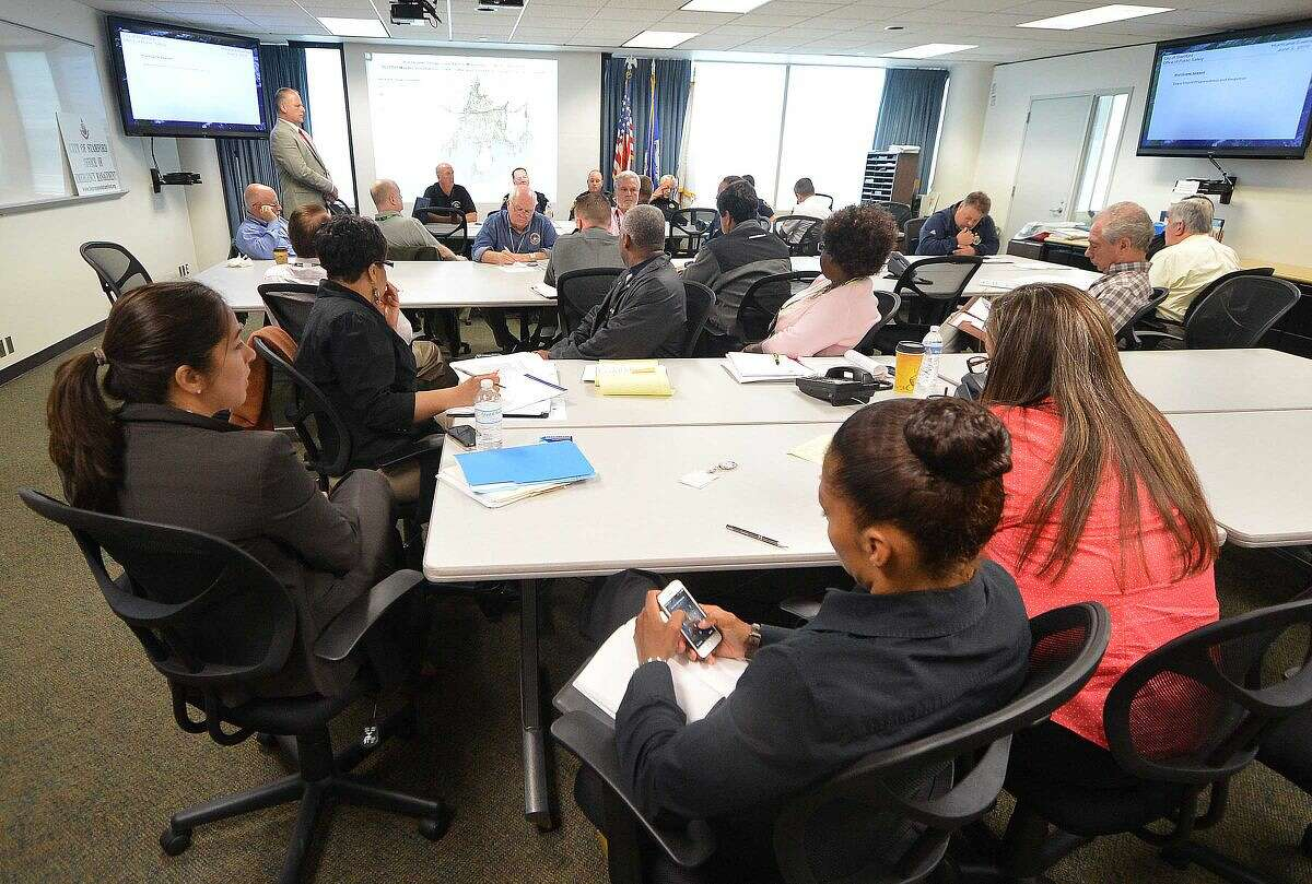 City officials and community agencies review protocols for hurricane preparedness during a meeting at the Stamford Emergency Operations Center.