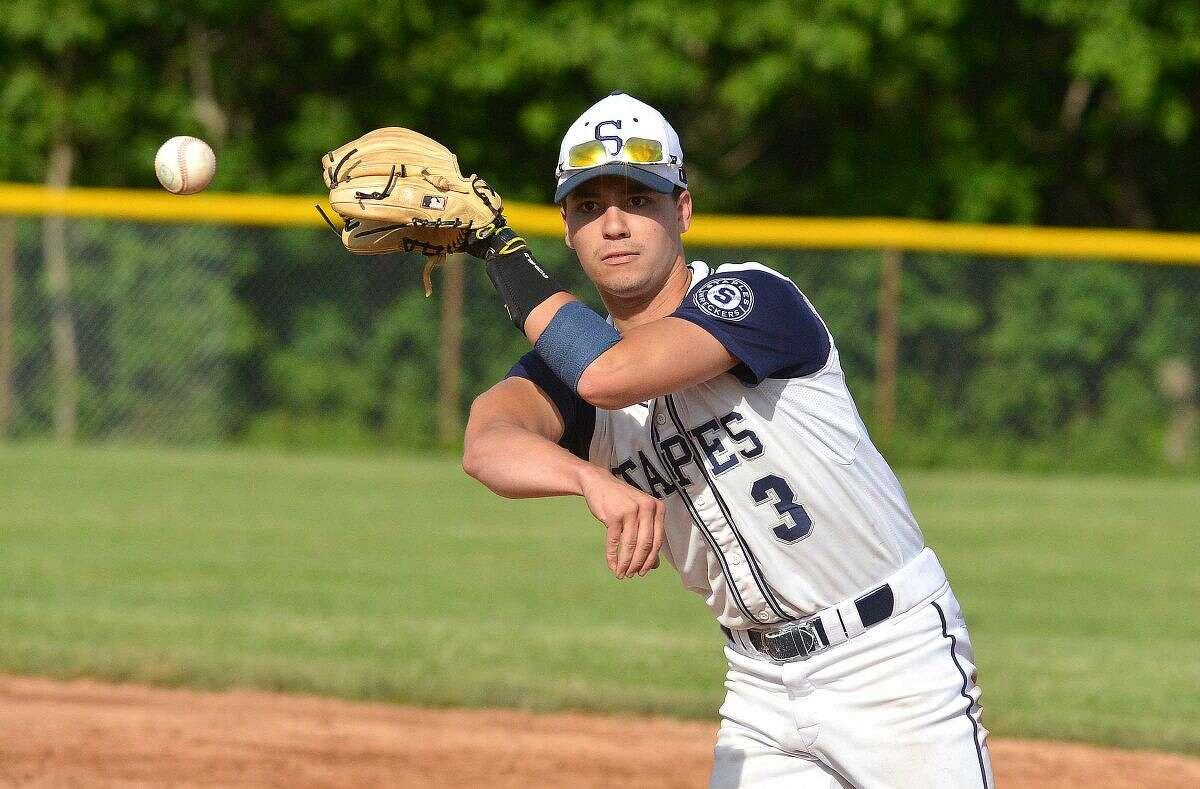 Staples' Michael Cusa throws over to first base against Hamden on Wednesday. (Hour Photo/Alex von Kleydorff)