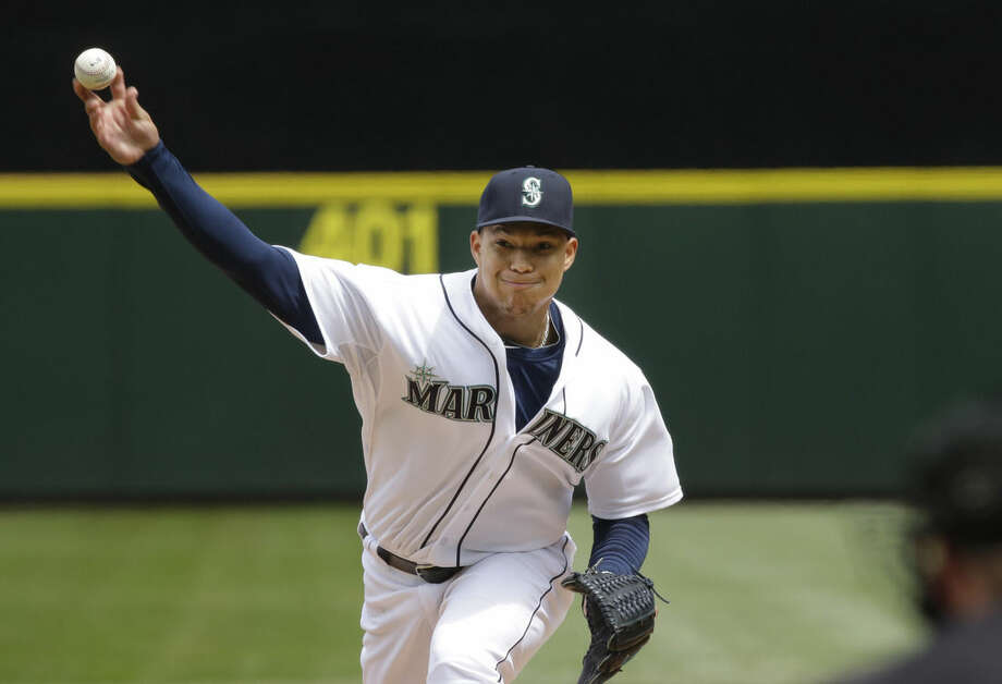 Seattle Mariners starting pitcher Taijuan Walker throws against the New York Yankees in the first inning of a baseball game, Wednesday, June 3, 2015, in Seattle. (AP Photo/Ted S. Warren)