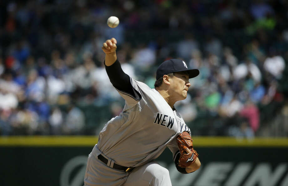 New York Yankees starting pitcher Masahiro Tanaka throws against the Seattle Mariners in the sixth inning of a baseball game, Wednesday, June 3, 2015, in Seattle. (AP Photo/Ted S. Warren)