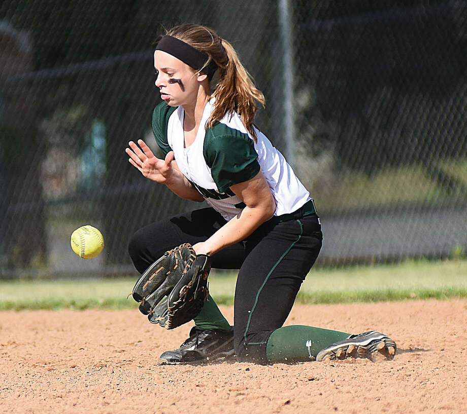 Hour photo/John Nash - Norwalk shortstop Nicole Bonanni plays a grounder during Wednesday's CIAC Class LL softball state tournament game in Norwalk.