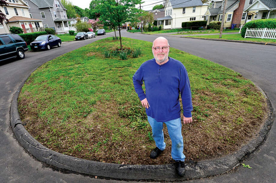 "Hour photo / Erik Trautmann Al Raymond, lifetime partner of Dianne Witkowsky who was a long-time leader of the Spring Hill/Norwalk Hospital Neighborhood Association and passed away Oct. 28, 2013, urged the Common Council to name the traffic island at Magnolia Avenue and Truman Street ""Dianne Witkowsky Memorial Park"" ."