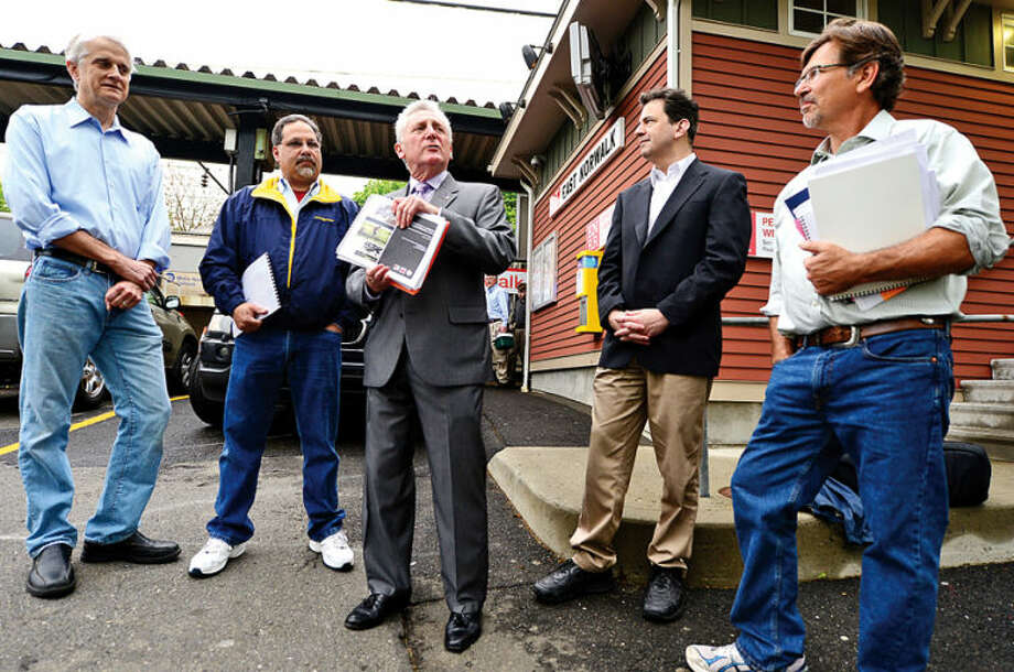 """Hour photo / Erik Trautmann Mayor Harry Rilling, center, announces the formation of """"Norwalk Bike/Walk Task Force"""" including at far left, Jud Aley, and far right, Mike Mushak, as Democratic candidate for the 142nd district Andy Garfunkel and Representative Chris Perone (D-137) look on at westbound side of East Norwalk Train Station Thursday."""