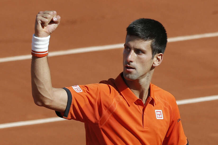 Serbia's Novak Djokovic clenches his fist after scoring a point in the quarterfinal match of the French Open tennis tournament against Spain's Rafael Nadal at the Roland Garros stadium, in Paris, France, Wednesday, June 3, 2015. (AP Photo/Christophe Ena)
