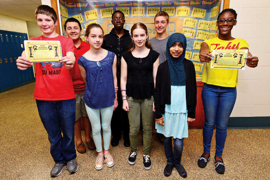 Hour photo / Erik Trautmann Ponus Ridge Middle School students Alex Wilson, Roger Campos, Michaela Silva, Nathan Moise, Kaitlyn Covello, Michael Macari, Hamma Qureshi and Jazmin Bien-Aime were rewarded golden tickets for respectful and responsible behavior as part of the school's Positive Behavioral Interventions and Supports (PBIS) program. Ponus Ridge Middle School was recently selected as a Connecticut PBIS Banner School by the State Education Resource Center (SERC). The purpose of the program is to recognize schools that have successfully implemented a school wide system for Positive Behavioral Interventions and Supports (PBIS).
