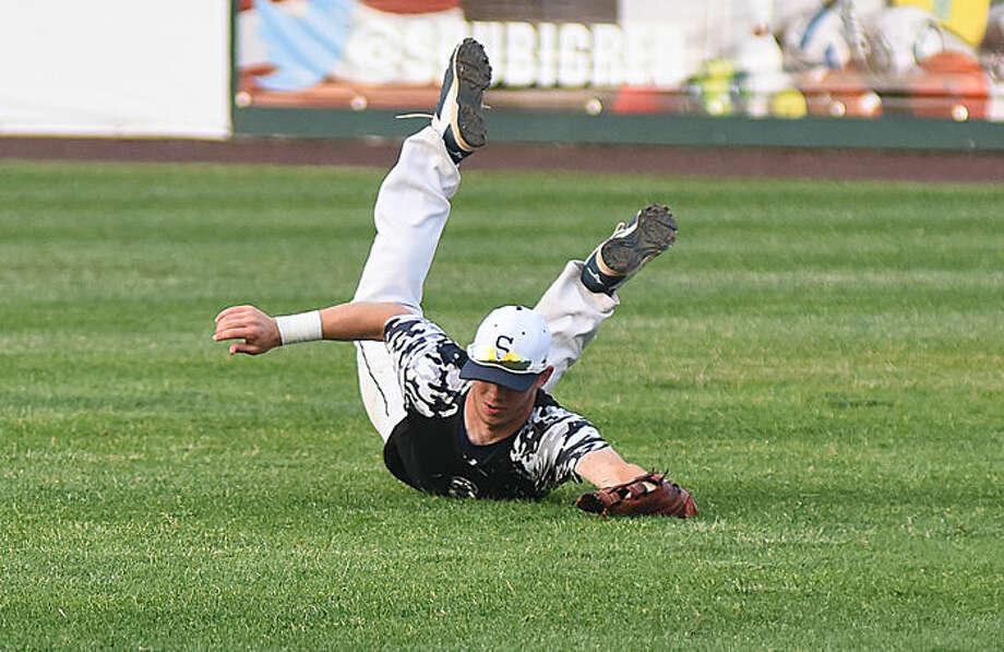 Hour photo/John Nash - Action photos from Friday's FCIAC baseball championship game.