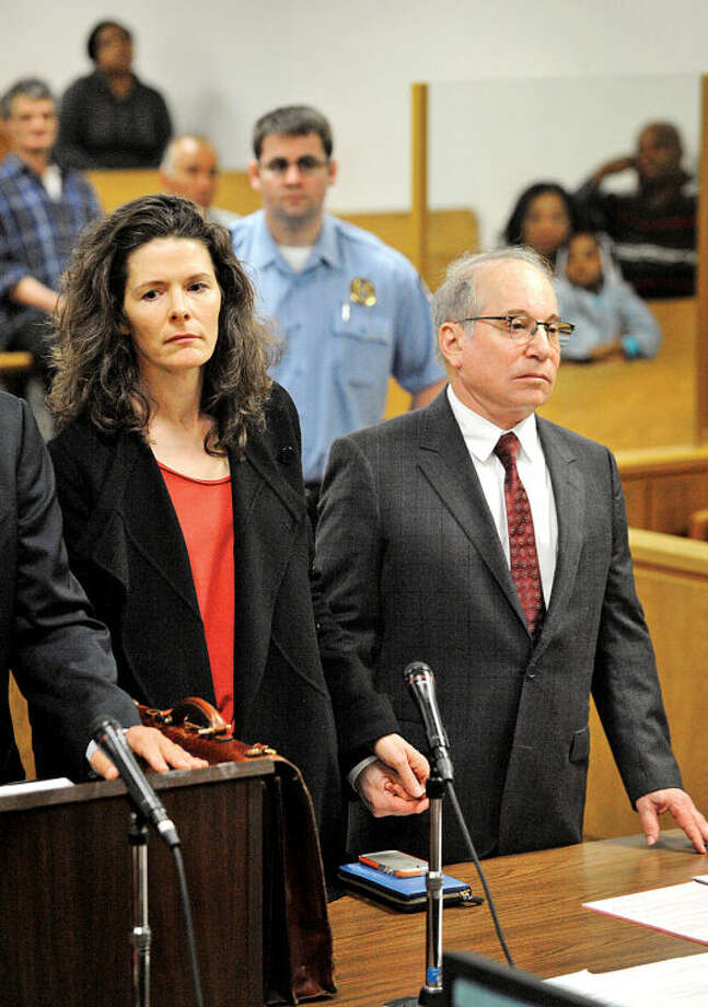 Paul Simon and his wife Edie Brickell hold hands inside the Norwalk Conn. Superior Court House Friday May, 16, 2014 for a domestic dispute hearing . (Pool Photo/Douglas Healey).
