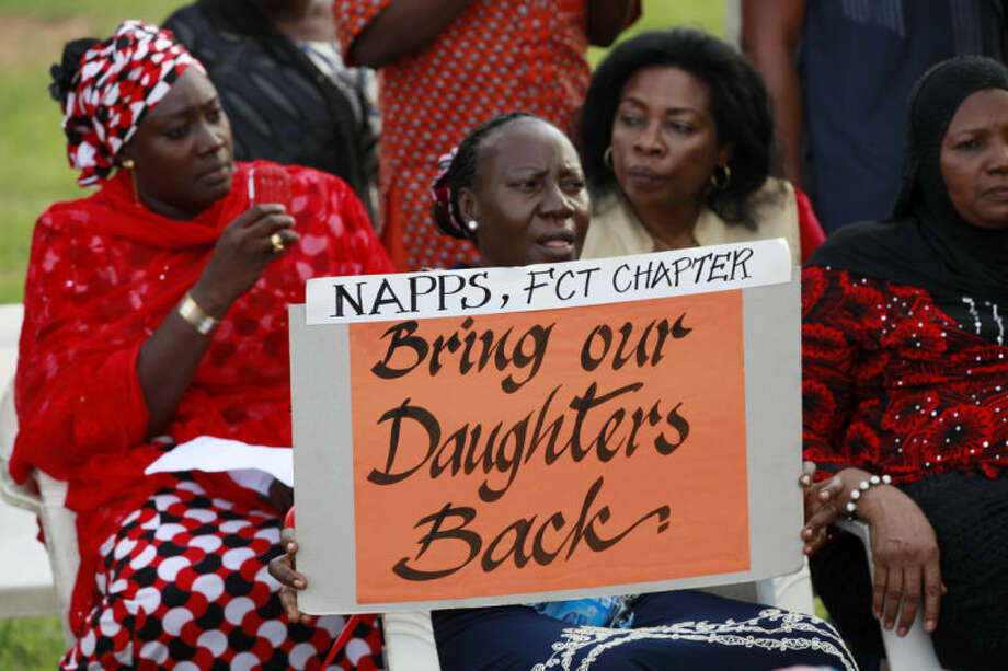 Women attend a sit down rally calling on the government to rescue the kidnapped school girls of the Chibok secondary school, in Abuja, Nigeria, Thursday, May 15, 2014. Islamic militants again attacked the remote Nigerian town from which nearly 300 schoolgirls were kidnapped, Nigeria's military said Wednesday, resulting in a firefight that killed 12 soldiers and led angry troops to fire into the air when their commanding officer came to pay respects to those killed at a barracks in Maiduguri, the state capital. (AP Photo/Sunday Alamba)