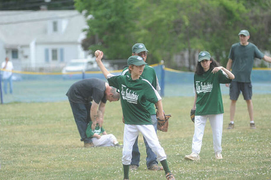 King Industries Champions against the Westport Winners Sunday for the Norwalk Little League Challenger Division game at the Broadriver field in Norwalk. Hour photo/Matthew Vinci