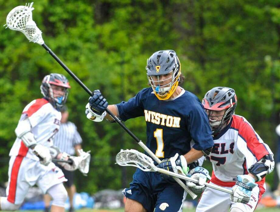 SWC boys lacrosse semifinal game between Weston and New Fairfield high schools on Tuesday night, May 24, 2016, at Weston High School, Weston, Conn.