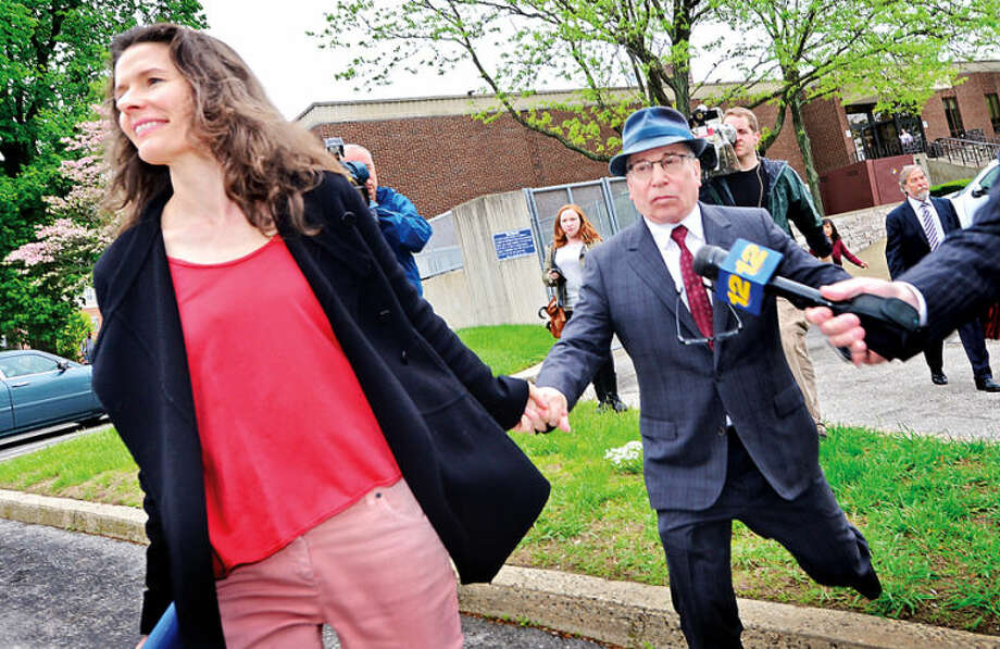 Hour photo / Erik Trautmann Edie Brickell and husband Paul Simon were in Norwalk Superior Court Friday asking for a continuance on the domestic dispute case.