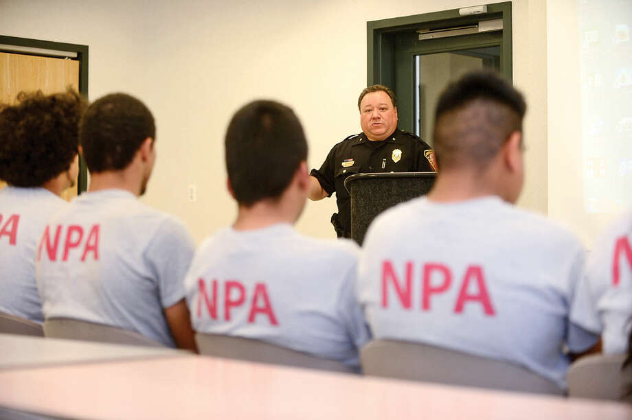 Deputy Chief Ashley Gonzalez addresses students from Pathways Academy's Justice and Law Academy program as they celebrate their graduation for the program Wednesday, May 25, 2016 at the Norwalk Police Department Community Room Wednesday May 25, 2016. The community policing program is a collaboration between Pathway Academy and the Norwalk Police for at-risk students at the academy.