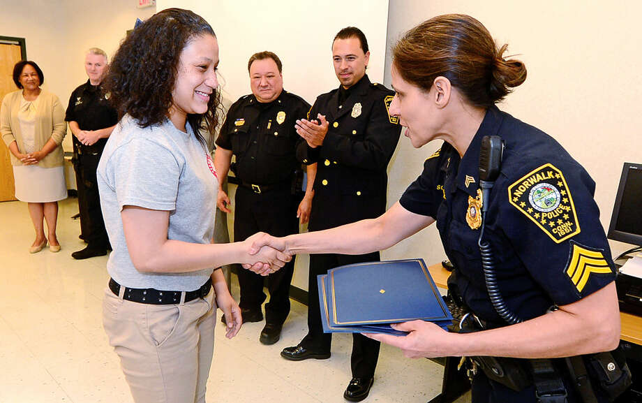 Seargent Sophia Golino congratulates students from Pathways Academy's Justice and Law Academy program including Nylene Lara as they celebrate their graduation for the program Wednesday, May 25, 2016 at the Norwalk Police Department Community Room Wednesday May 25, 2016. The community policing program is a collaboration between Pathway Academy and the Norwalk Police for at-risk students at the academy.
