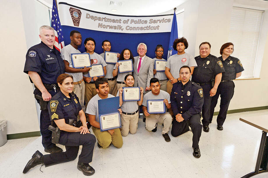 Students from Pathways Academy's Justice and Law Academy program celebrate their graduation for the program Wednesday, May 25, 2016 at the Norwalk Police Department Community Room Wednesday May 25, 2016. The community policing program is a collaboration between Pathway Academy and the Norwalk Police for at-risk students at the academy.