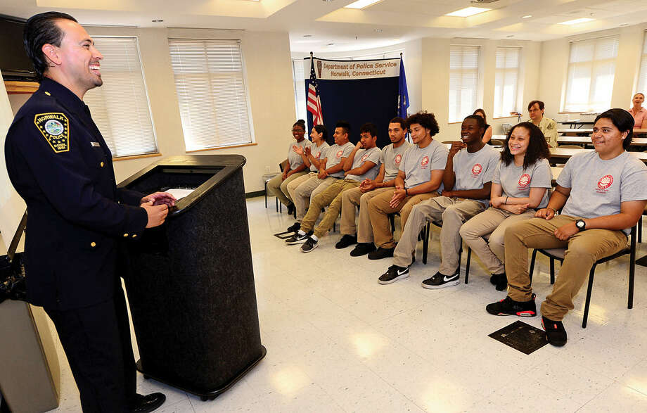 Students from Pathways Academy's Justice and Law Academy program celebrate their graduation for the program Wednesday, May 25, 2016 with School Resource Officer, Phil Taborda, at the Norwalk Police Department Community Room Wednesday May 25, 2016. The community policing program is a collaboration between Pathway Academy and the Norwalk Police for at-risk students at the academy.