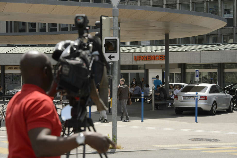 A TV team is waiting in front of Geneva's General Hospital in Geneva, Switzerland, Sunday, May 31, 2015. U.S. Secretary of State John Kerry broke his leg in bike crash outside of Geneva on Sunday and called off the rest of a four-nation diplomatic trip that was to include stops in the Spanish and French capitals. Kerry was returning to the United States after X-rays at the Swiss hospital confirmed a fracture of his right femur. (Martial Trezzini/Keystone via AP)