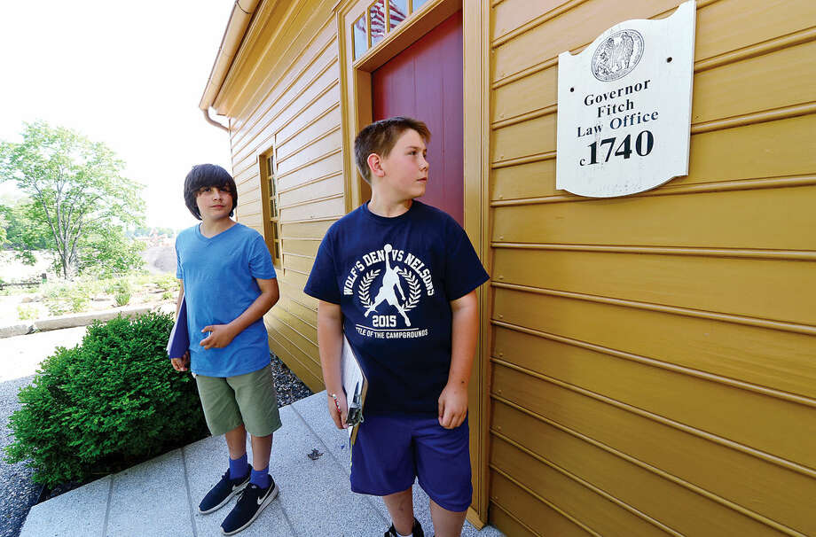Roton Middle School's 7th grade students including Aidan Devingo and Jake Seco participate in the annual Memorial Day scavenger hunt where the students are asked to seek out four memorials in Norwalk, Conn. at three different sites including The Mill Hill Historic Complex Wednesday May 25, 2016.