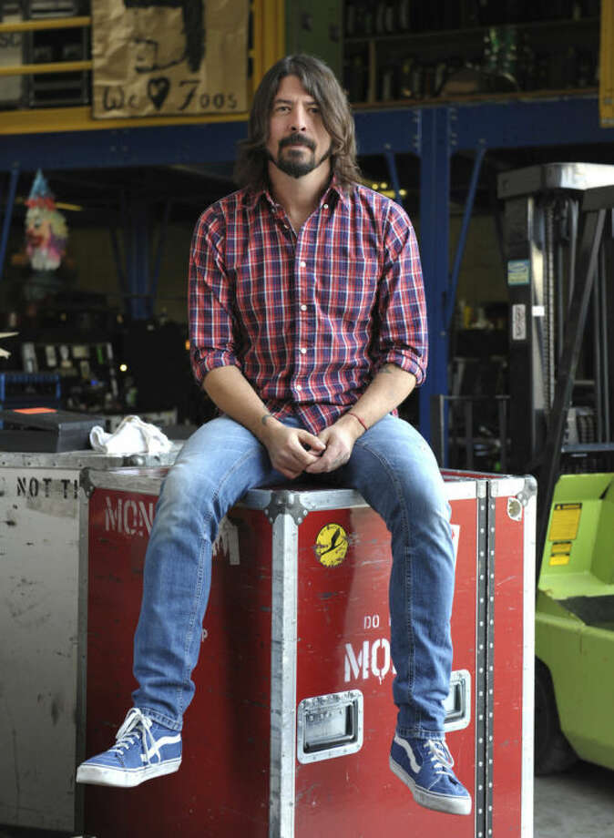 FILE - This Jan. 9, 2013 file photo shows musician Dave Grohl poses for a portrait at 606 Sound in Los Angeles. The Foo Fighters are heading to the small screen. The rock band announced Thursday, May 15, 2014, it will film the making of their new album which will air on HBO. The series will feature the band recording one song in eight different cities, including Chicago, Los Angeles and New York. The show and album will premiere in the fall. (Photo by John Shearer/Invision/AP, File)