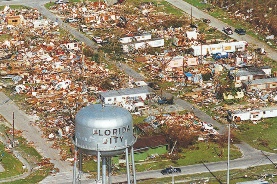 AP file photoThis Aug. 25, 1992 file photo shows the water tower, a landmark in Florida City, Fla. still standing over the ruins of the Florida coastal community that was hit by the force of Hurricane Andrew. Cities like Tampa, Houston, Jacksonville and Daytona Beach historically get hit with major hurricanes every 20 to 40 years, according to meteorologists. But those same places have now gone at least 70 years, sometimes more than a century, without getting smacked by those monster storms, according to data analyses by an MIT hurricane professor and The Associated Press.