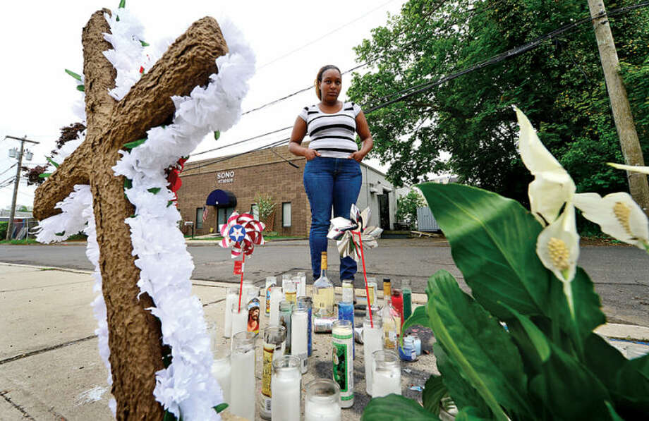 Hour photo / Erik Trautmann Friends of shooting victim Jimmy Martinez set up a make shift memorial on the corner of Leonard and Isaacs Streets Friday.