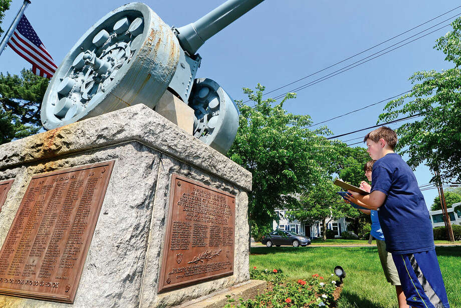 Roton Middle School's 7th grade students including Aidan Devingo and Jake Seco participate in the annual Memorial Day scavenger hunt where the students are asked to seek out four memorials in Norwalk, Conn. at three different sites including The Norwalk Town Green Wednesday May 25, 2016.