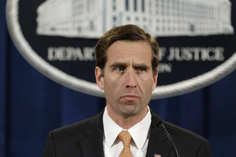 FILE - In this Feb. 5, 2013 file photo, Delaware Attorney General Beau Biden pauses while speaking at a news conference at the Justice Department in Washington. On Saturday, May 30, 2015, Vice President Joe Biden announced the death of his son, Beau, from brain cancer. (AP Photo/Jacquelyn Martin)