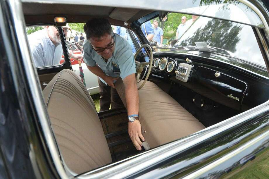Hour Photo/Alex von Kleydorff. Owner Santi Spadaro shows the tag on the original upholstery in his 1953 Lancia Aurelia B10 eneterd for judging in the 2015 Greenwich Concours d'Elegance on Sunday