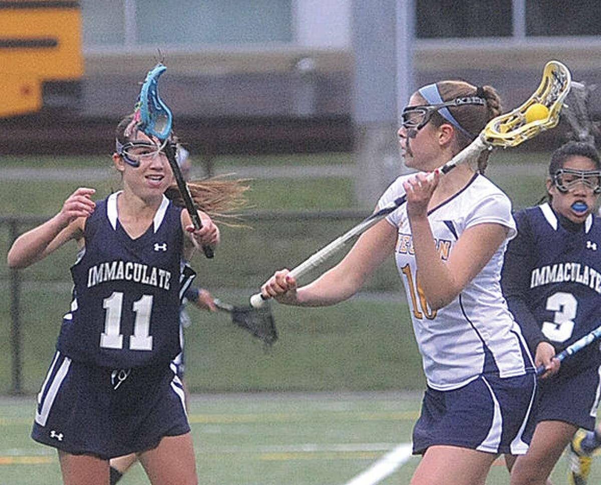 Weston girls lacrosse, Julia Asphar, Immaculate Jamie Pierce. Hour photo/Matthew Vinci