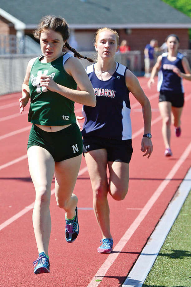 Hour photo / Erik Trautmann Norwalk High's Claire Turner runs the 1600m as Brien McMahon and Norwalk High go head to head in oudoor track Saturday at Brien Mcmahon High School.