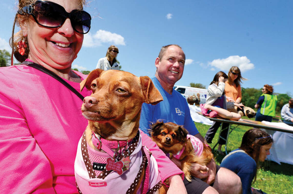 Hour photo / Erik Trautmann Debbie Boczer and her Chihuahua Sophie attend The Hour Parade of Pets Pet Expo Saturday at Taylor Farm Park.