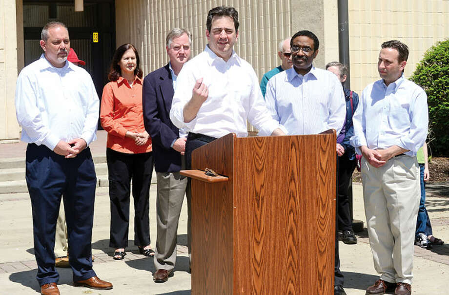 Hour photo / Erik Trautmann State Representative Chris Perone receives endorsements from Speaker of the House Brendan Sharkey and House Majority Leader Joe Aresimowicz as they make an important education announcement in addition to endorsing State Representative Bruce Morris during a press conference Saturday at Norwalk High School.