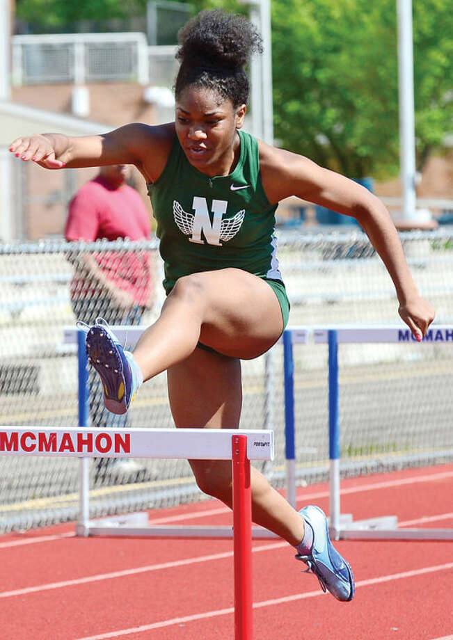 Hour photo / Erik Trautmann NHS Tamia Taylor places second in the hurdles as Brien McMahon and Norwalk High go head to head in oudoor track Saturday at Brien Mcmahon High School.