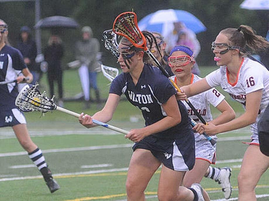 Wilton girls lacrosse against Ridgefield Monday. Hour photo/Matthew Vinci