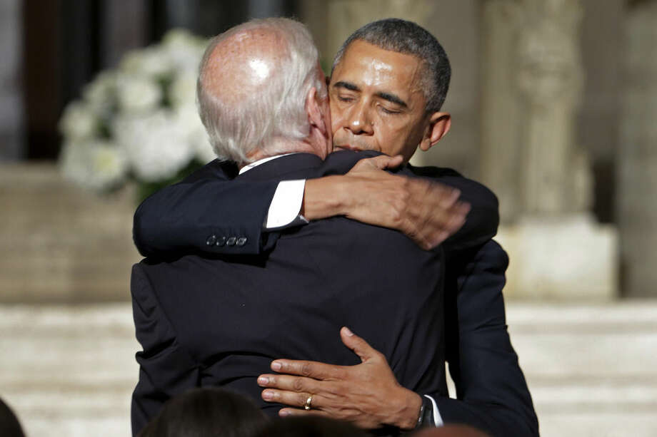 President Barack Obama hugs Vice President Joe Biden after delivering the eulogy in honor of Biden's son, former Delaware Attorney General Beau Biden, Saturday, June 6, 2015, at St. Anthony of Padua Church in Wilmington, Del. Biden, Vice President Biden's eldest son, died at the age of 46 after a battle with brain cancer. (AP Photo/Pablo Martinez Monsivais, Pool)