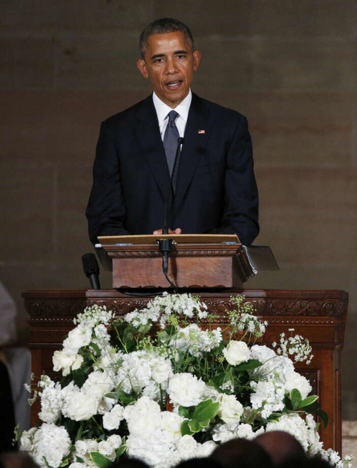 President Barack Obama delivers the eulogy in honor of former Delaware Attorney General Beau Biden, Saturday, June 6, 2015, at St. Anthony of Padua Church in Wilmington, Del. Biden, Vice President Joe Biden's eldest son, died at the age of 46 after a battle with brain cancer. (Kevin Lamarque/Pool Photo via AP)