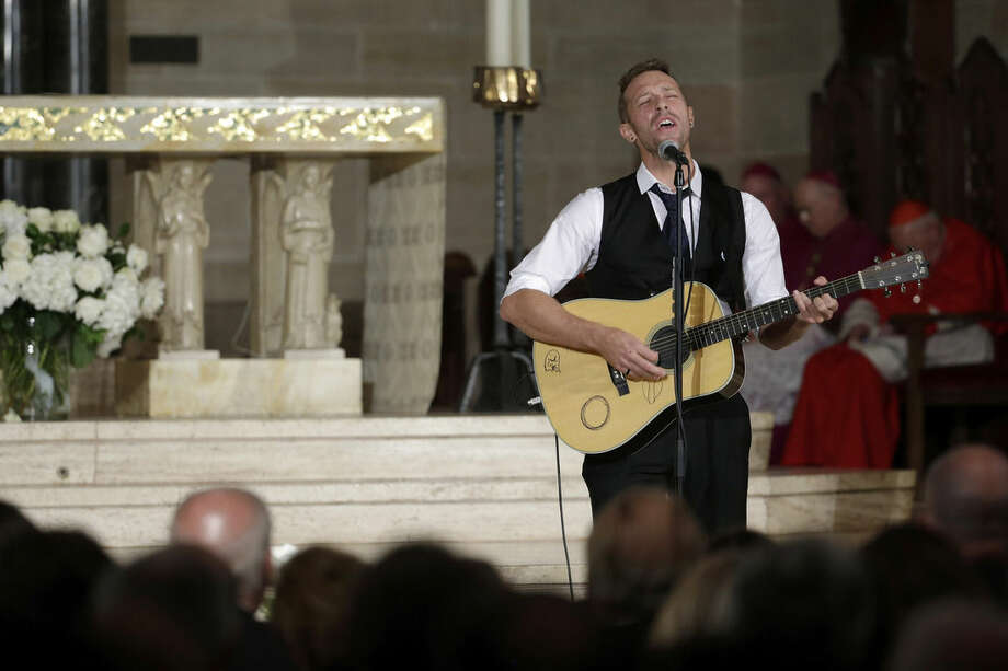 """Chris Martin on the group Coldplay performs """"Til Kingdom Comes"""" during funeral services for Vice President Joe Biden's son, former Delaware Attorney General Beau Biden, Saturday, June 6, 2015, at St. Anthony of Padua Church in Wilmington, Del. Vice President Joe Biden's eldest son, died at the age of 46 after a battle with brain cancer. (AP Photo/Pablo Martinez Monsivais, Pool)"""