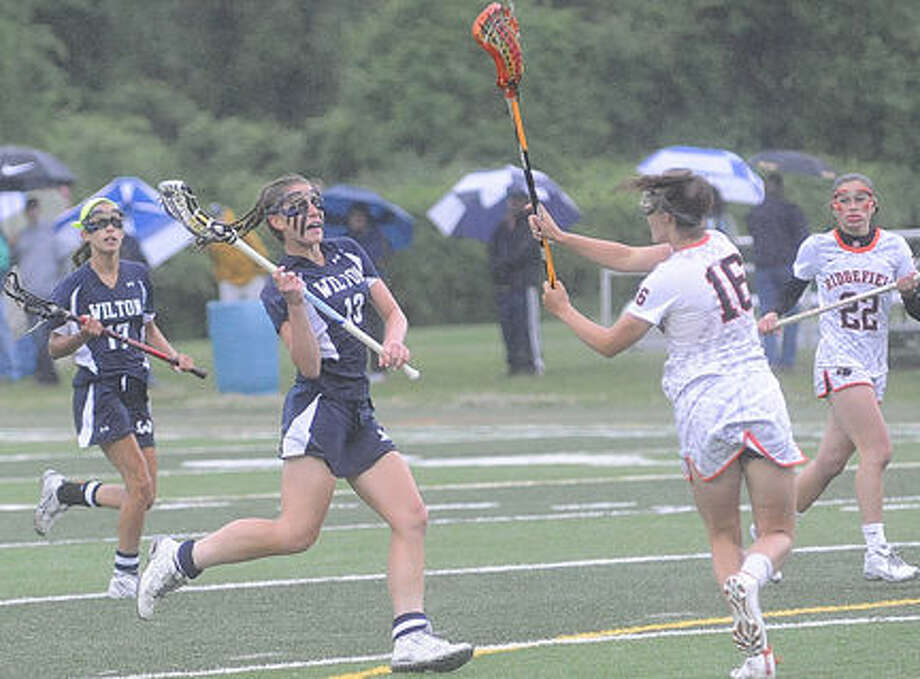 Wilton girls lacrosse against Ridgefield Monday. Hour photo/Matthew Vinci